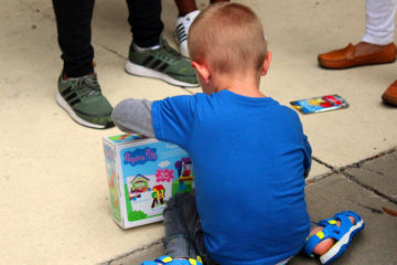 A child plays with toys at His House