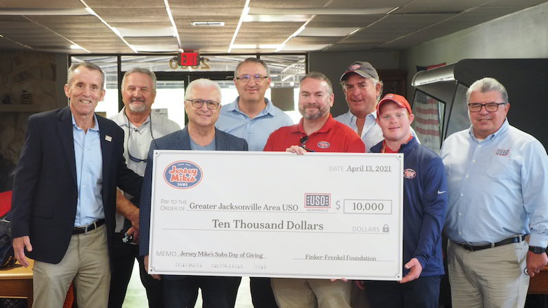 Finker-Frenkel Family Foundation members present a check to the USO in Jacksonville, FL